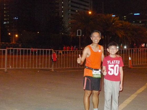 with my son at the finish line