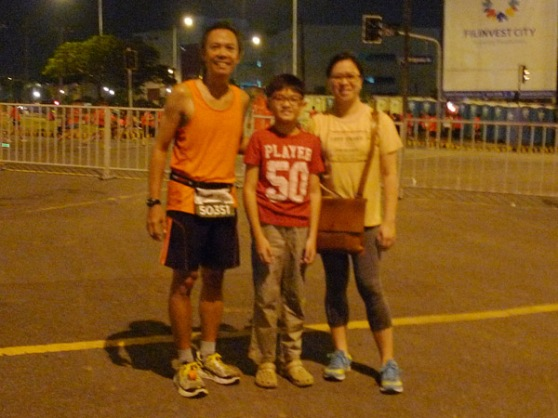 with my wife and son at the finish line